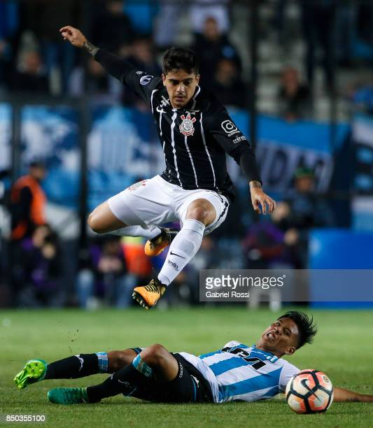 Fagner of Corinthians jumps over Matias Zaracho of Racing Club during a second leg match between Racing Club and Corinthians as part of round of 16...