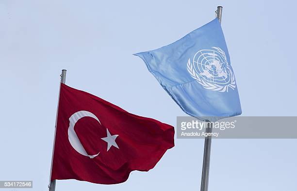 Fags of the United Nations and Turkey wave outside the Titanic Hotel where Midterm Review of the Istanbul Programme of Action during the flag raising...