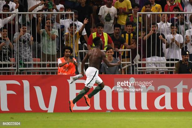 Fahad Al Muwallad of Saudi Arabia celebrates scoring the opening goal during the FIFA World Cup qualifier match between Saudi Arabia and Japan at the...