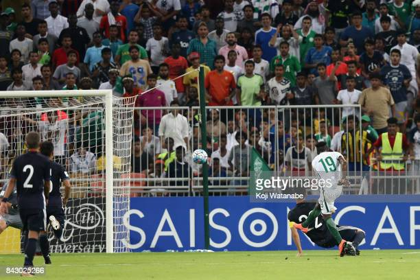 Fahad Al Muwallad of Saudi Arabia scores the opening goal during the FIFA World Cup qualifier match between Saudi Arabia and Japan at the King...