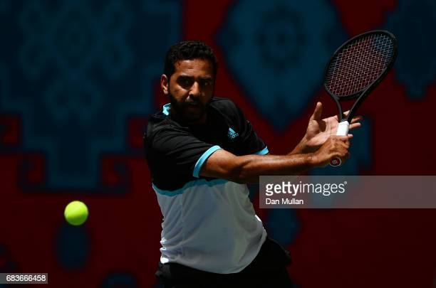 Fahad Al Saad of Saudi Arabia plays a backhand against Rasul Gojayev of Azerbaijan in the Mens Tennis Singles first round match during day five of...