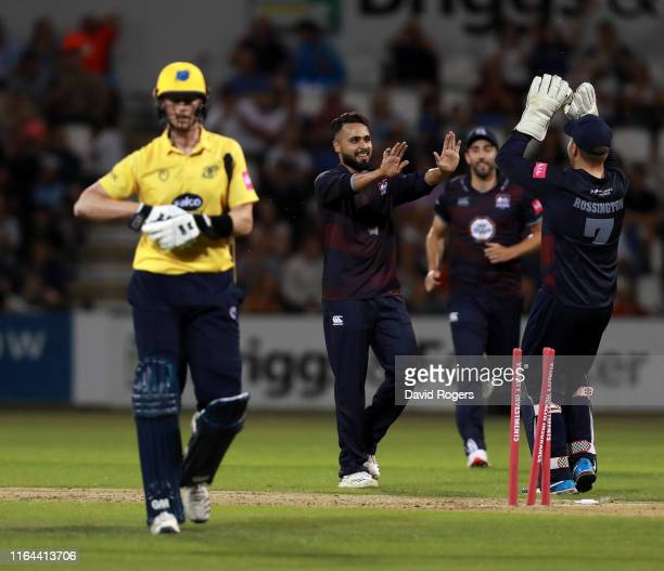 Faheem Ashraf of Northamptonshire celebrates with team mates after bowling out Adam Hose during the Vitality Blast match between Northamptonshire...