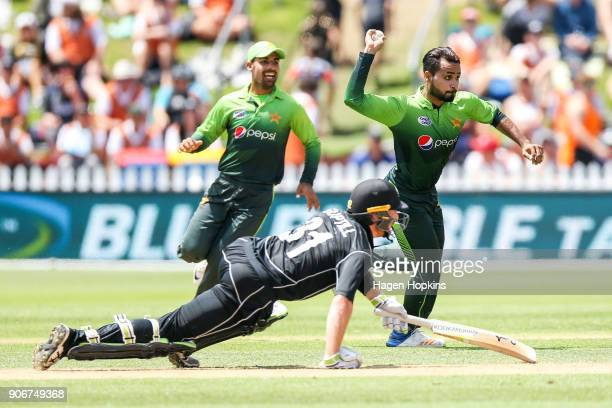 Faheem Ashraf of Pakistan attempts to run out Martin Guptill of New Zealand during game five of the One Day International Series between New Zealand...