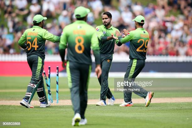 Faheem Ashraf of Pakistan celebrates with Sarfraz Ahmed and Shadab Khan after taking the wicket of Ross Taylor of New Zealand during game five of the...