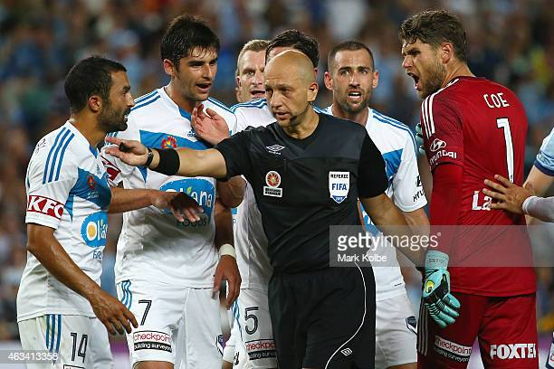 Fahid Ben Khalfallah Gui Finkler Besart Berisha Mark Milligan Carl Valeri and Nathan Coe of Melbourne Victory argue with referee Strebre Dilovski...
