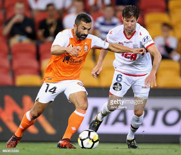 Fahid Ben Khalfallah of Brisbane and Vince Lia of Adelaide compete for the ball during the round two ALeague match between the Brisbane Roar and...