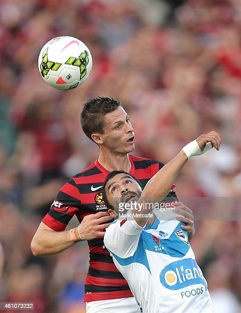 Fahid Ben Khalfallah of Melbourne Victory competes for the ball with Shannon Cole of Western Sydney Wanderers during the round 15 ALeague match...