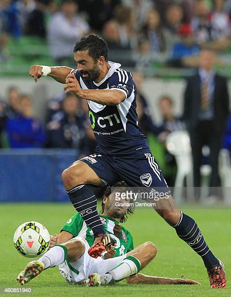 Fahid Ben Khalfallah of Melbourne Victory is tackled during the round 13 ALeague match between the Melbourne Victory and Newcastle Jets at AAMI Park...