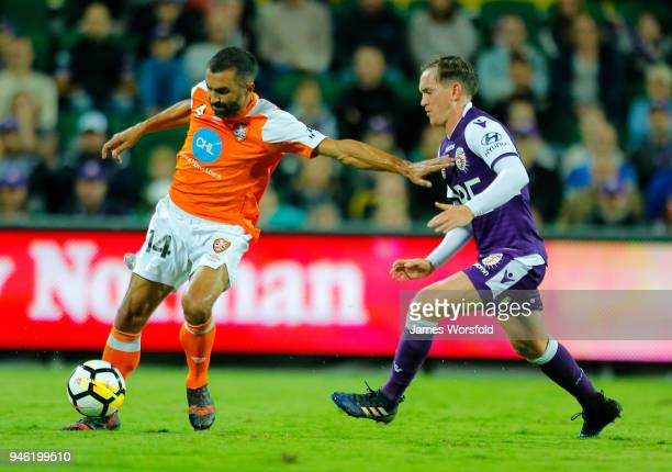 Fahid Ben Khalfallah of the Brisbane Roar holds off Neil Kilkenny of the Perth Glory in play during the round 27 ALeague match between the Perth...