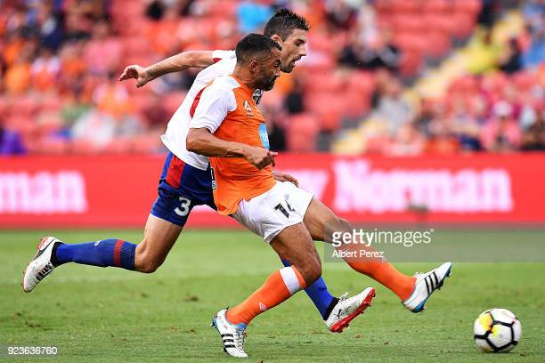 Fahid Ben Khalfallah of the Roar and Jason Hoffman of the Jets compete for the bal during the round 21 ALeague match between the Brisbane Roar and...