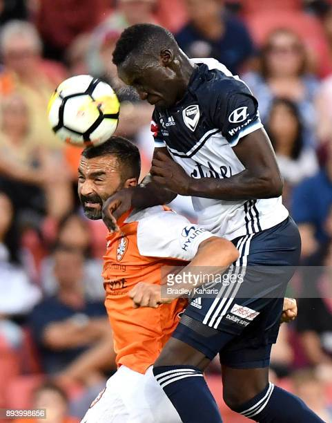 Fahid Ben Khalfallah of the Roar and Thomas Deng of the Victory challenge for the ball during the round 11 ALeague match between the Brisbane Roar...