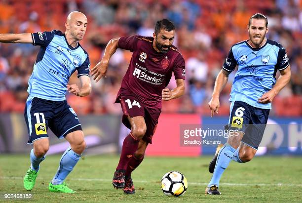 Fahid Ben Khalfallah of the Roar takes on the defence during the round 15 ALeague match between the Brisbane Roar and Sydney FC at Suncorp Stadium on...
