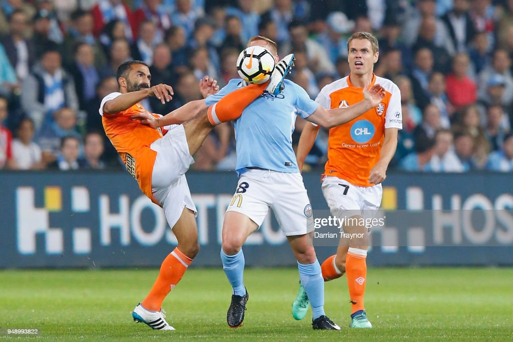 Fahid Ben Khalfallah of the Roar takes the balll close to Oliver Bozanic of Melbourne City face during the A-League Elimination Final match between the Melbourne City and the Brisbane Roar at AAMI Park on April 20, 2018 in Melbourne, Australia.