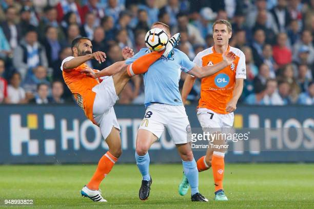 Fahid Ben Khalfallah of the Roar takes the balll close to Oliver Bozanic of Melbourne City face during the ALeague Elimination Final match between...