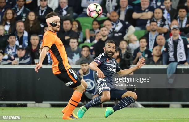 Fahid Ben Khalfallah of the Victory and Jack Hingert of the Roar compete for the ball during the ALeague Semi Final match between Melbourne Victory...