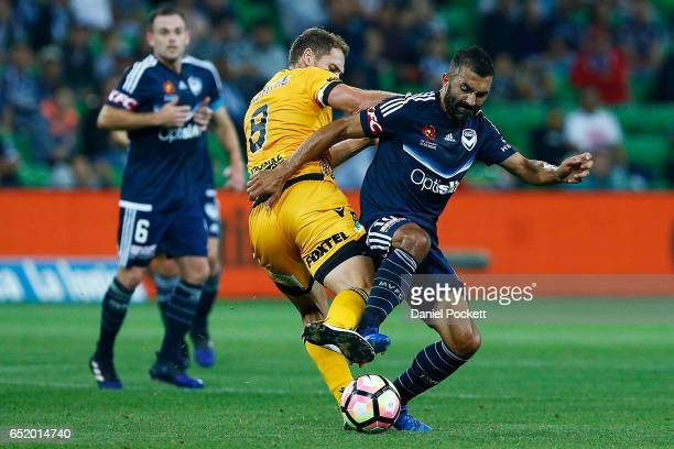 Fahid Ben Khalfallah of the Victory and Rostyn Griffiths of the Glory contest the ball during the round 23 ALeague match between Melbourne City FC...