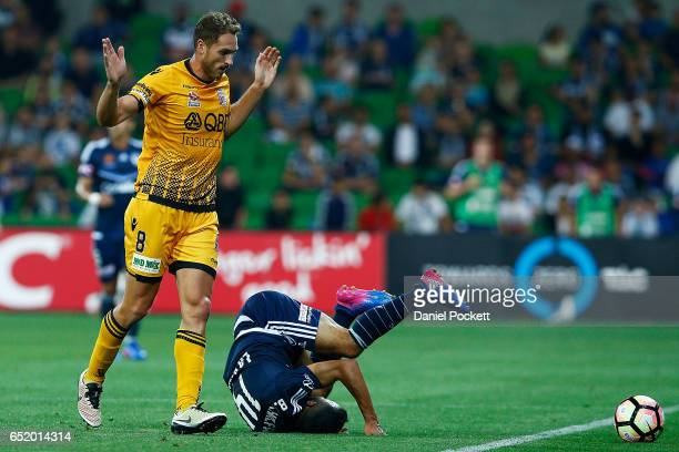 Fahid Ben Khalfallah of the Victory falls after contesting the ball with Rostyn Griffiths of the Glory during the round 23 ALeague match between...