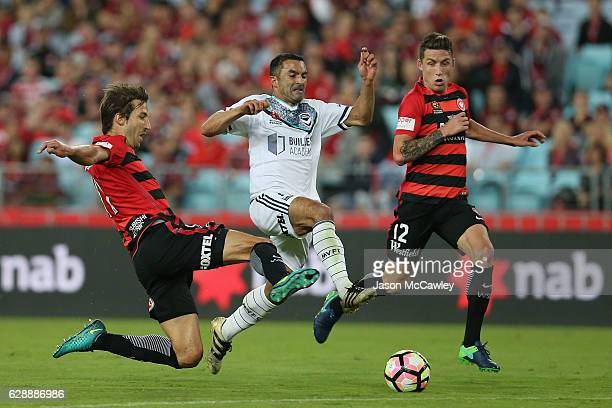 Fahid Ben Khalfallah of the Victory is challenged by Aritz Borda of the Wanderers during the round 10 ALeague match between the Western Sydney...