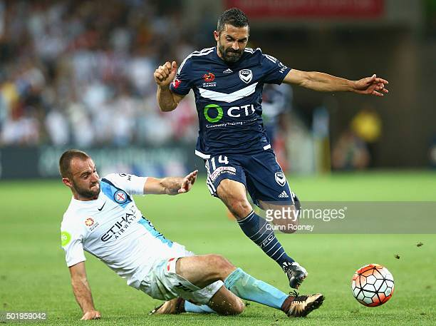 Fahid Ben Khalfallah of the Victory is tackled by Ivan Franjic of the City during the round 11 ALeague match between Melbourne City FC and Melbourne...