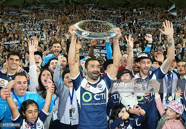 Fahid Ben Khalfallah of the Victory shows the trophy to the crowd after the Victory won the 2015 ALeague Grand Final match between the Melbourne...