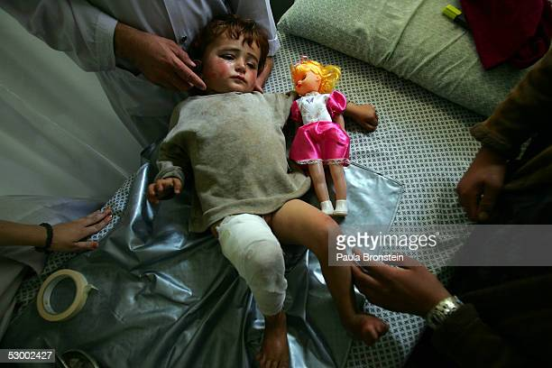 Fahima, 3 years, gets her dressing changed after getting physical therapy on her leg at the International Committee of the Red Cross Orthropedic...