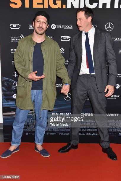 Fahri Yardim and Marc Hosemann attend the 'Steig Nicht Aus' Premiere on April 9 2018 in Berlin Germany