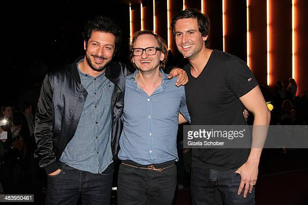 Fahri Yardim and Milan Peschel Tom Beck attend the premiere of the film 'Irre sind maennlich' at Mathaeser Filmpalast on April 10 2014 in Munich...