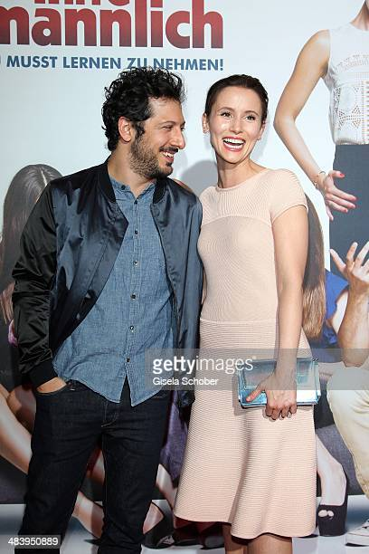Fahri Yardim and Peri Baumeister attend the premiere of the film 'Irre sind maennlich' at Mathaeser Filmpalast on April 10 2014 in Munich Germany