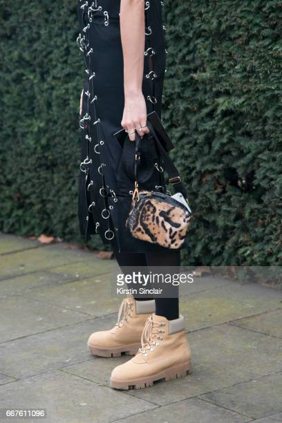 Fahsion writer and founder of heywomancom Veronika Heilbrunner wears a Christopher Kane dress and bag Acne boots and a Metallica tshirt on day 4 of...