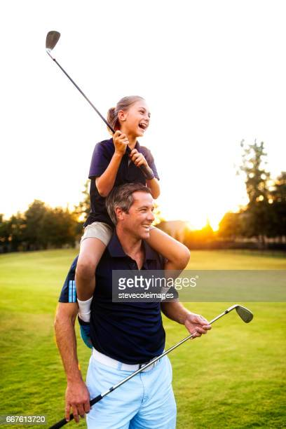 fahter and daughter golf - golf stock pictures, royalty-free photos & images