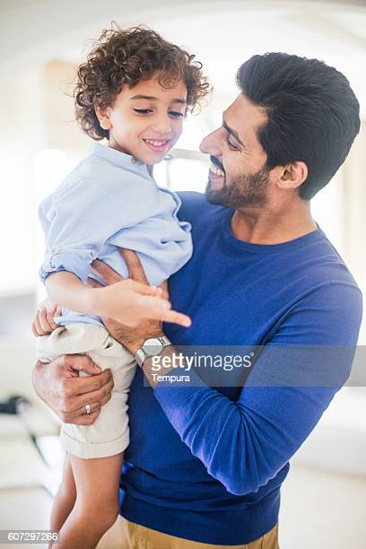 Fahter and son at home in Dubai.