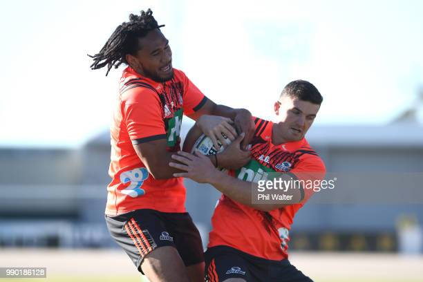 Faiane and Bryn Gatland of the Auckland Blues contest the ball during a Blues Super Rugby training session at Blues HQ on July 3 2018 in Auckland New...