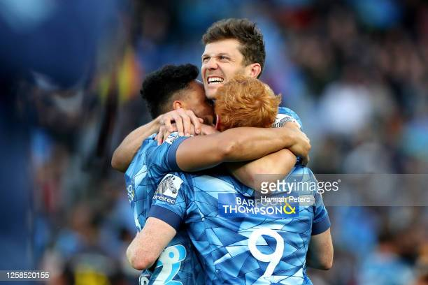 Faiane, Matt Duffie and Finlay Christie of the Blues celebrate after winning the round 7 Super Rugby Aotearoa match between the Blues and the Chiefs...