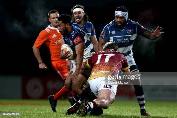 Faiane of Auckland is tackled by Joseph Walsh of Southland during the round nine Mitre 10 Cup match between Southland and Auckland at Rugby Park...