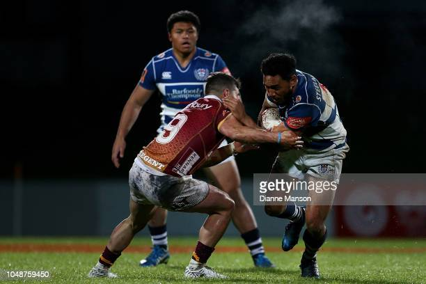 Faiane of Auckland is tackled by Nico Costa of Southland during the round nine Mitre 10 Cup match between Southland and Auckland at Rugby Park...