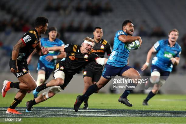 Faiane of the Blues makes a break during the round 14 Super Rugby match between the Blues and the Chiefs at Eden Park on May 18 2019 in Auckland New...