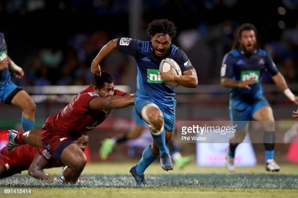 Faiane of the Blues makes a break during the round 15 Super Rugby match between the Blues and the Reds at Apia Park National Stadium on June 2 2017...