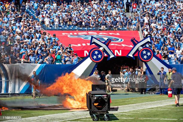 A failed pyrotechnic device bursts into flames before the game between the Tennessee Titans and Indianapolis Colts at Nissan Stadium on September 15...