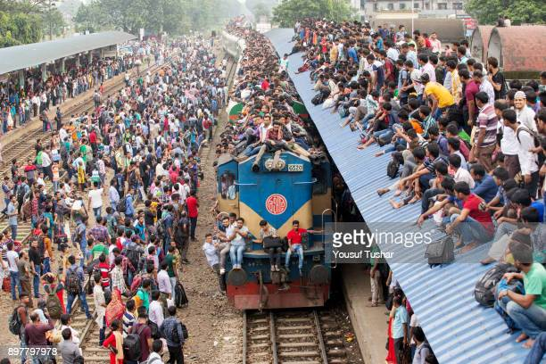 Failed to get place inside the train people are climbed on the roof and out side of the train during the time of Eidul Adha one of the biggest Muslim...