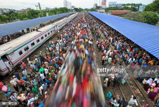 Failed to get place inside the train people are risky trevelling by train during the time of Eidul Adha one of the biggest Muslim religious festival...