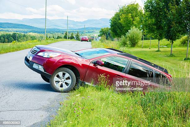 failed u-turn in treacherous ditch - ditch stock photos and pictures