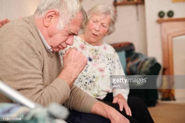 failing health - cough foto e immagini stock