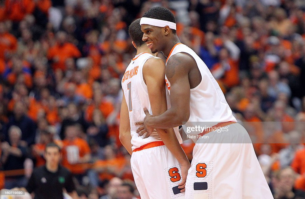 C.J. Fair #5 and Michael Carter-Williams #1 of the Syracuse Orange celebrate after a play during the game against the Notre Dame Fighting Irish at the Carrier Dome on February 4, 2013 in Syracuse, New York.