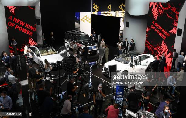 Fair goers inspect Mercedes cars during a press preview at the International Motor Show , on September 6, 2021 in Munich, southern Germany. -...