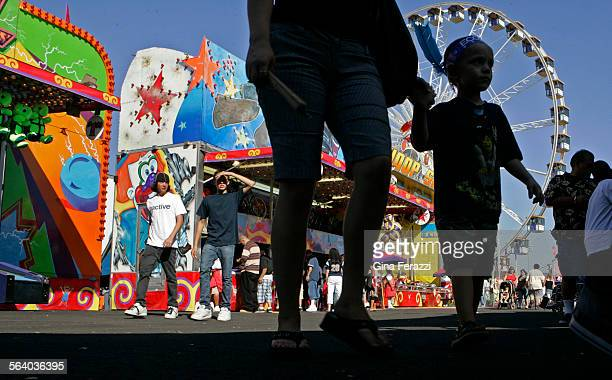 Fair goers make their way through the carnival at the opening day of the LA County Fair in Pomona Friday Sept 7 2007