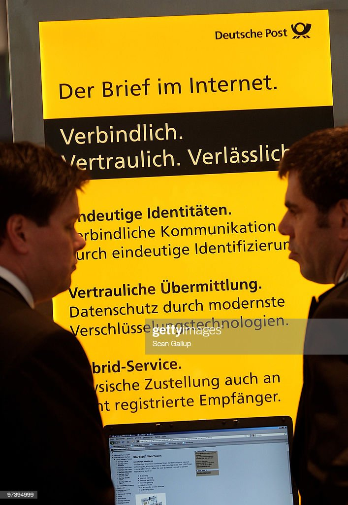 A fair hostess explains the Internet mail system of German postal service provider Deutsche Post at the CeBIT Technology Fair on March 3, 2010 in Hannover, Germany. CeBIT will be open to the public from March 2 through March 6.