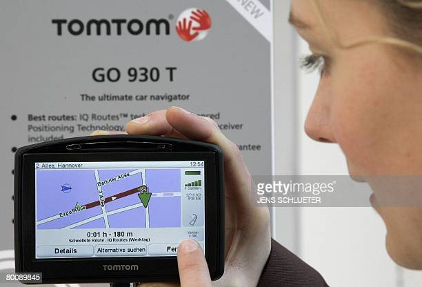 A fair hostess presents the new TomTom 'GO 930 T' navigation system at the CeBIT 2008 trade fair on March 3 2008 The world's biggest hightech fair...