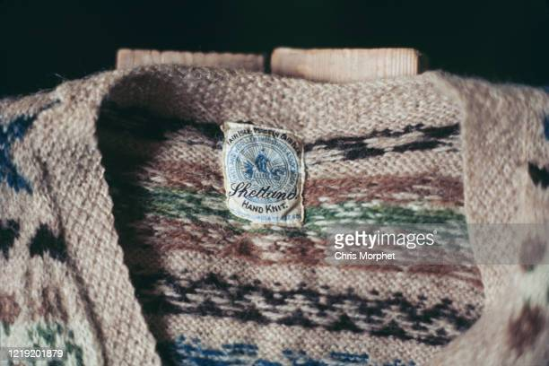 Fair Isle pattern sweater with its label showing, Fair Isle, Shetland Islands, Scotland, June 1970.