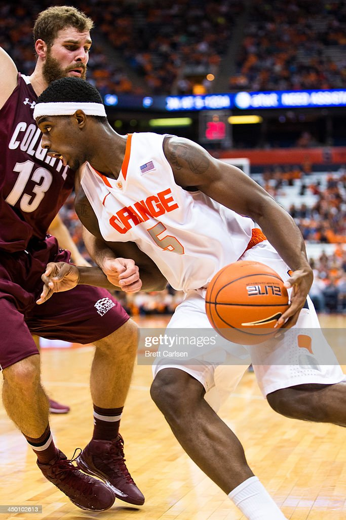 C.J. Fair #5 of Syracuse Orange is fouled by Murphy Burnatowski #13 of Colgate Raiders during the second half of a basketball game on November 16, 2013 at the Carrier Dome in Syracuse, New York. Syracuse defeated Colgate 69-50.