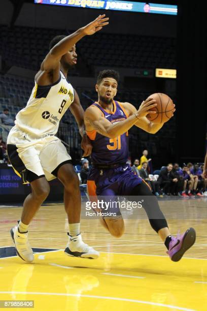 Fair of the Fort Wayne Mad Ants battles Askia Booker the Northern Arizona Sunns during their NBDL game at Memorial Coliseum on November 26 2017 in...